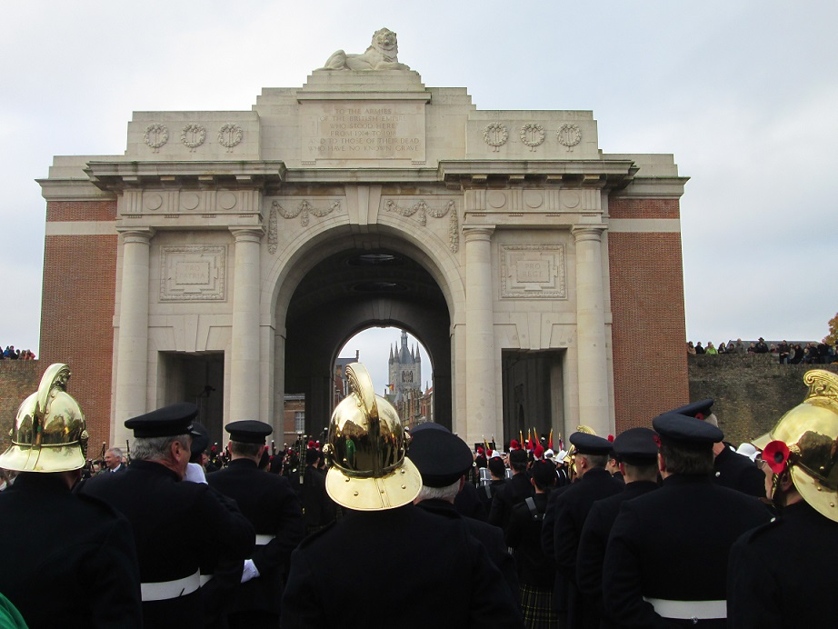 Firefighter, servicemen, and citizens stand together in remembrance of the fallen at the Menin Gate.[James Crisp]