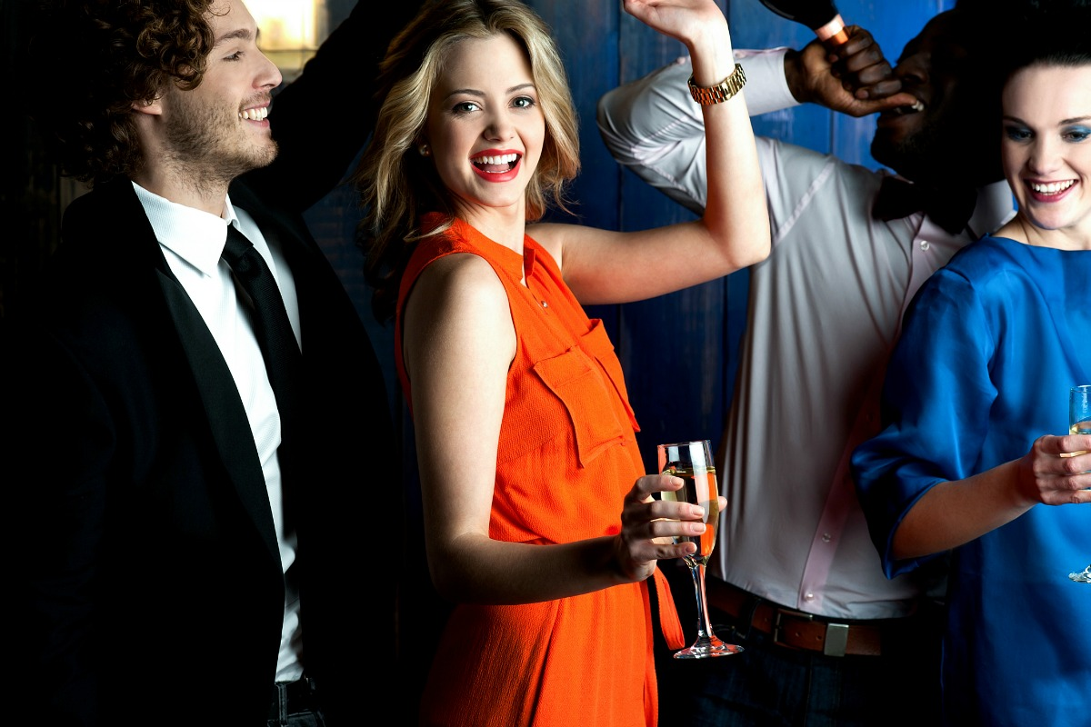 Young couples drinking and dancing in a club [Photo: Shutterstock.com]
