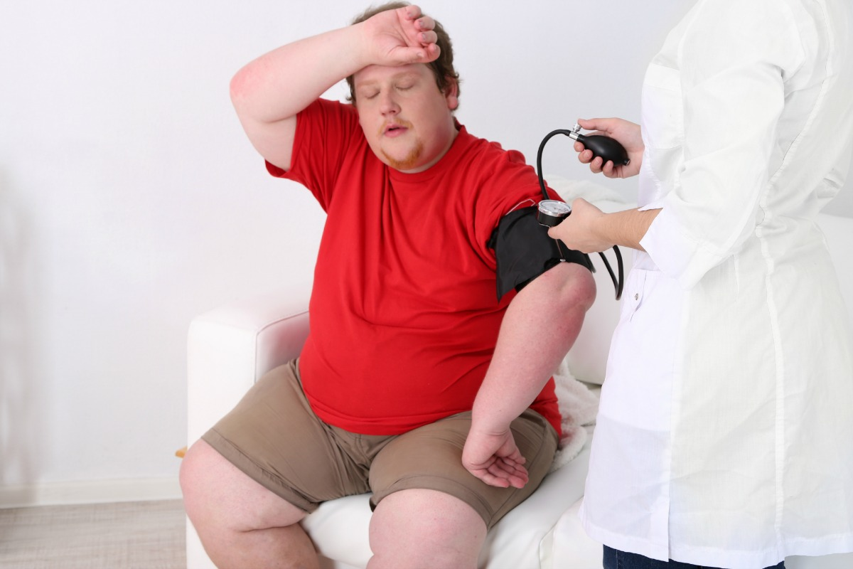 Doctor examining obesity patient [Photo: Shutterstock]