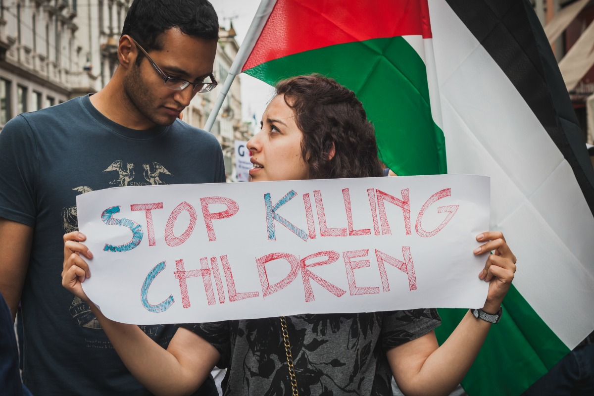 People march and protest against Gaza strip bombing in solidarity with Palestinians on July 26, 2014 in Milan [Photo: Shutterstock]