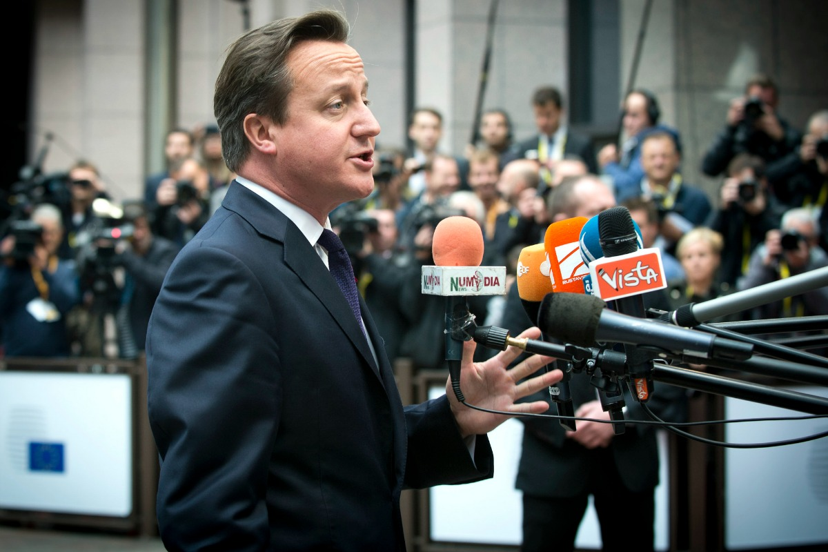 David Cameron, UK Prime Minister, arrives at the Council meeting in Brussels, Oct. 23, 2014 [European Council/Flickr]