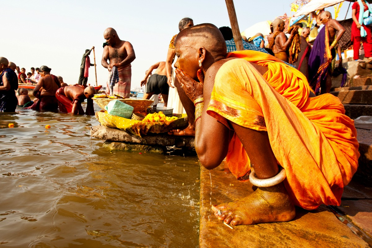 A Hindu woman takes ritual bath in the river Ganga on April 23, 2011 in the holy city of Varanasi, India [Shutterstock]