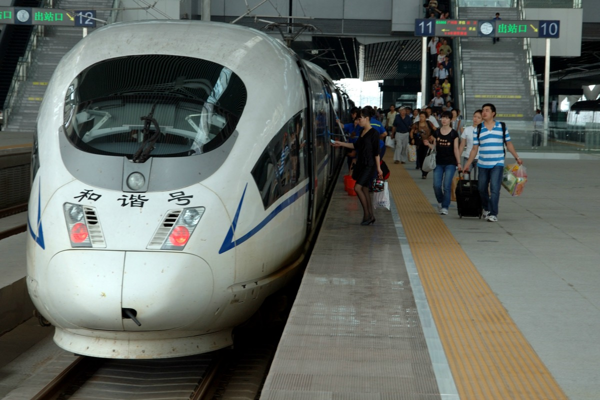 Passengers board train in newly build Guangzhou South station, China