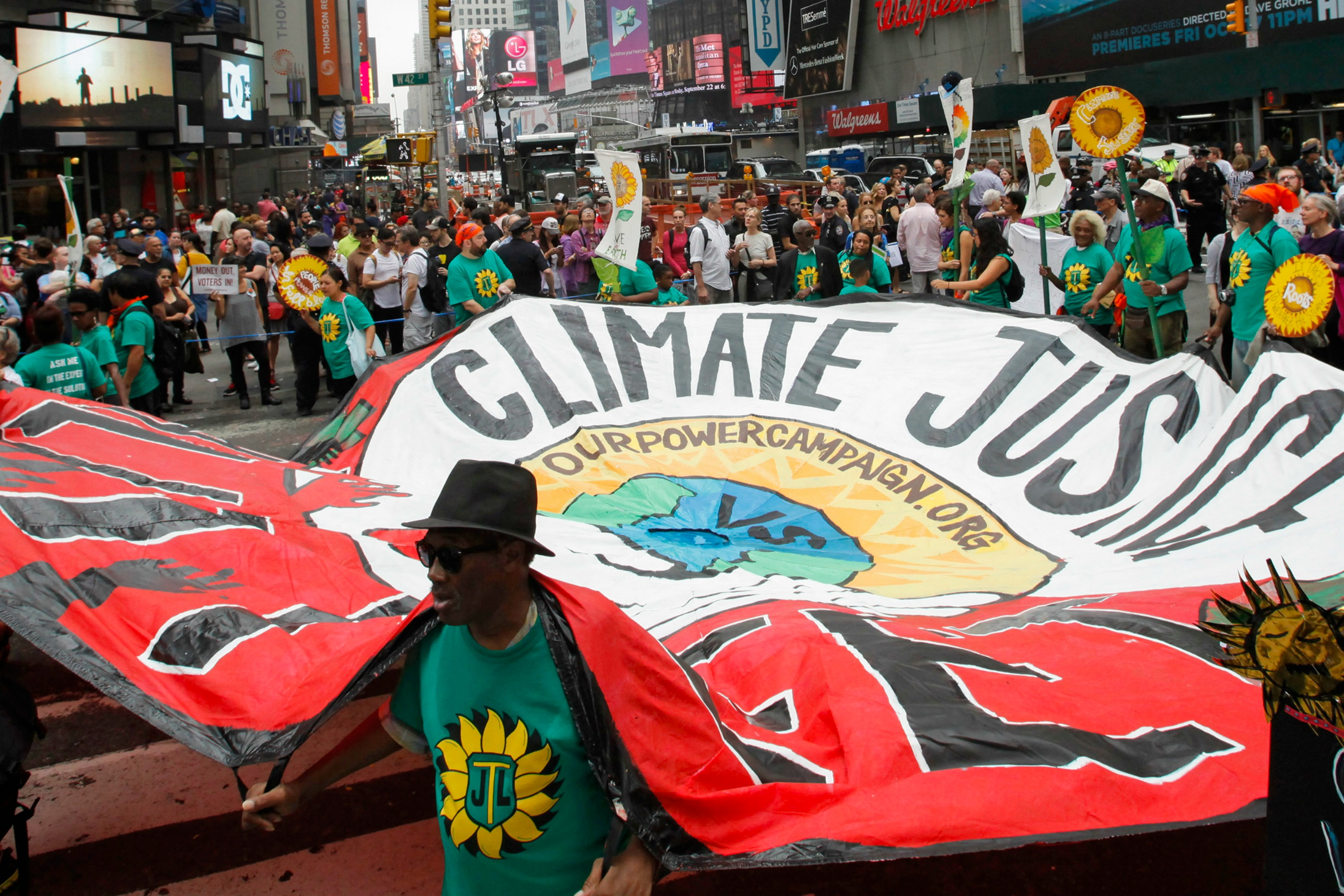 People march during a rally against climate change in New York, 21 September [Reuters]