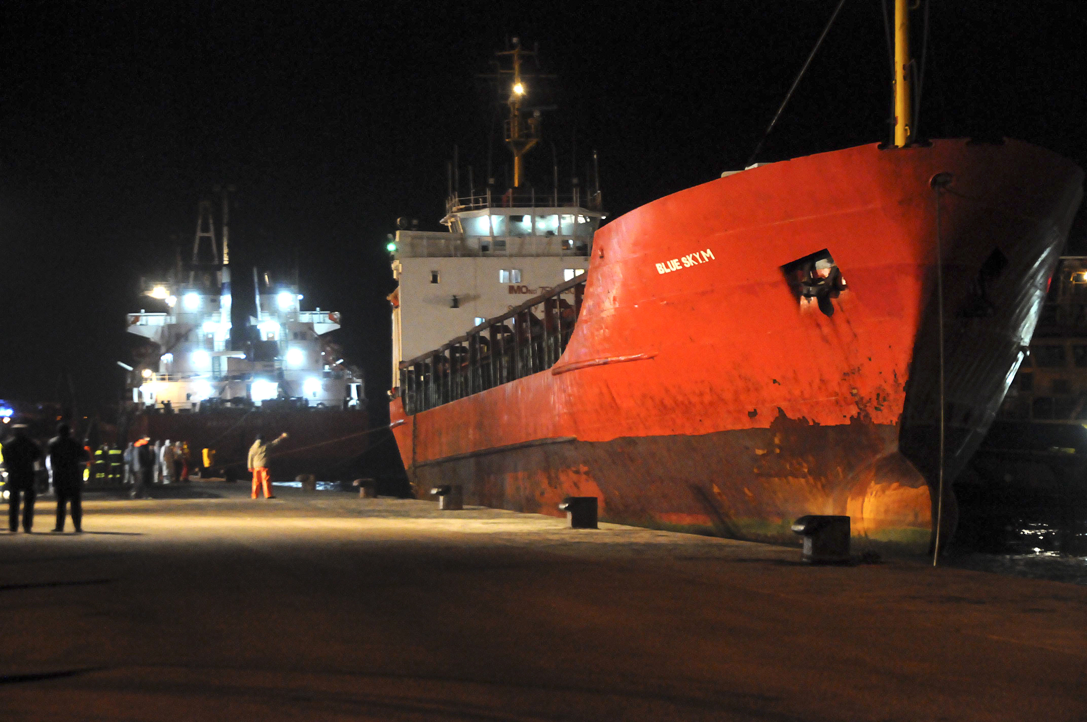 The Blue Sky M cargo ship docked at the Gallipoli harbour in southern Italy on 31 Dec. [Reuters]