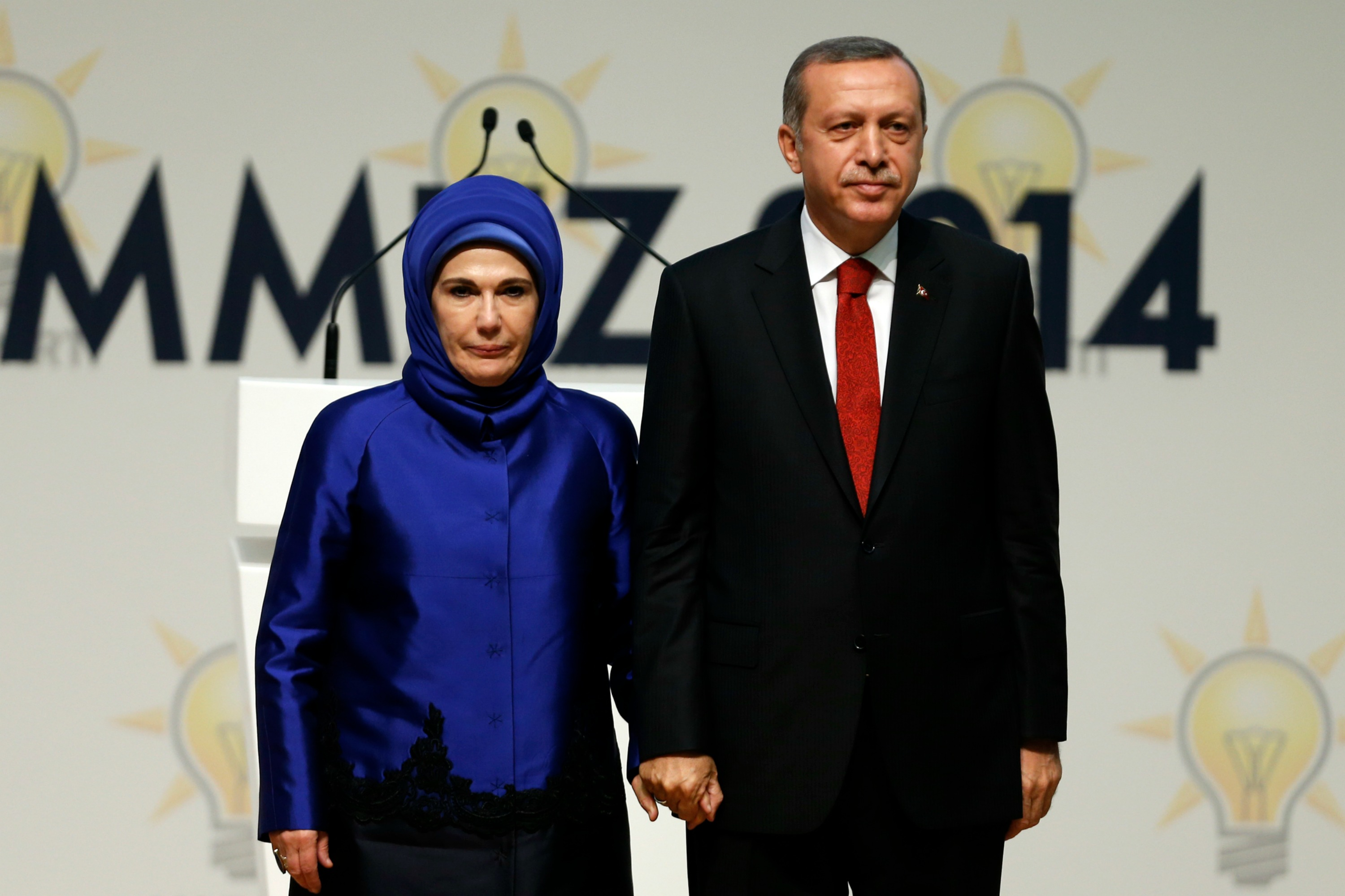 Erdogan and his wife Emine at a meeting where he is named as AKP candidate for the country's first direct presidential election [Reuters]