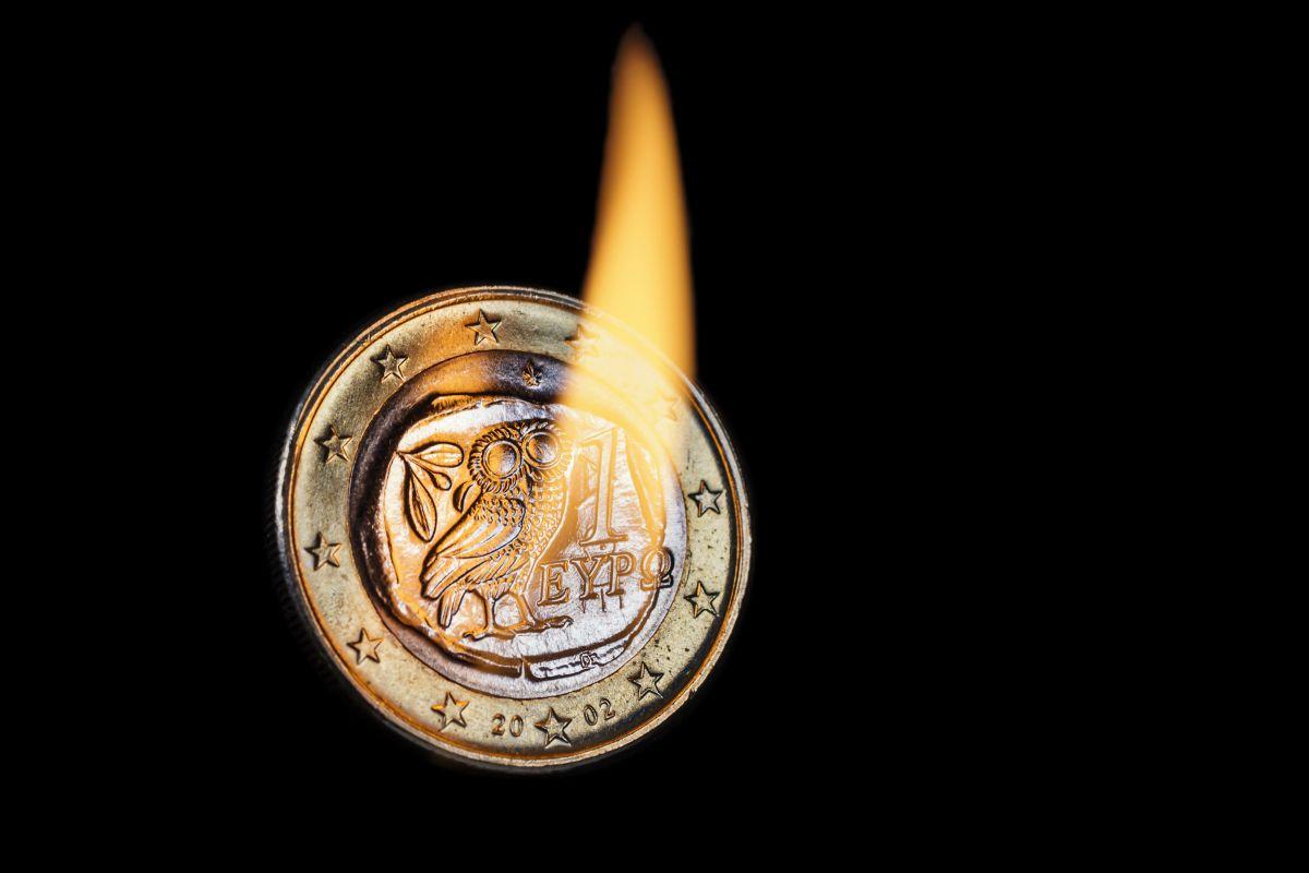 Burning greek euro coin